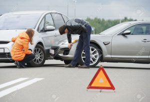 22844800-Car-collision-driver-man-and-woman-examining-damaged-automobile-cars-after-crash-accident-in-city-Stock-Photo